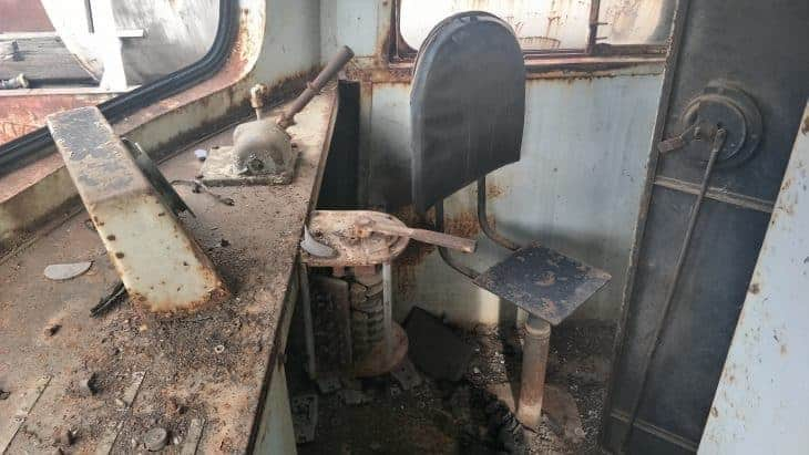 The drivers seat of an abandoned train in Bangkok.