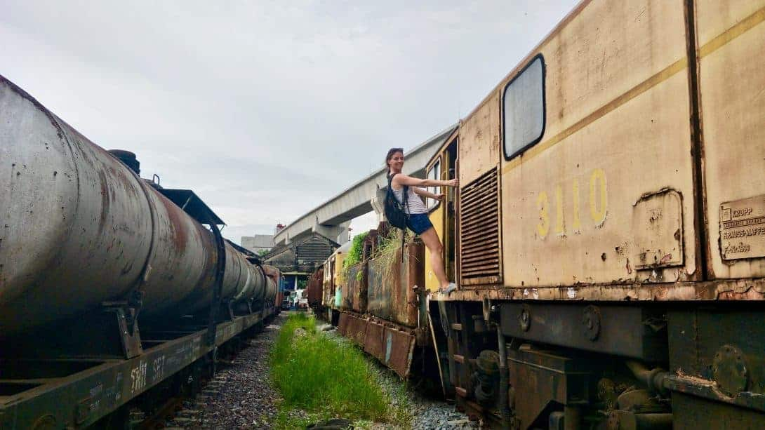 Climbing on an abandoned train in Bangkok.