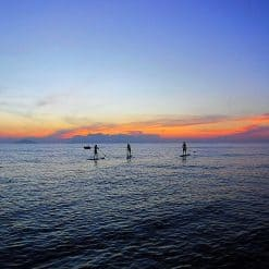 Stand Up Paddle Boarding at sunset, in Hoi An, Vietnam