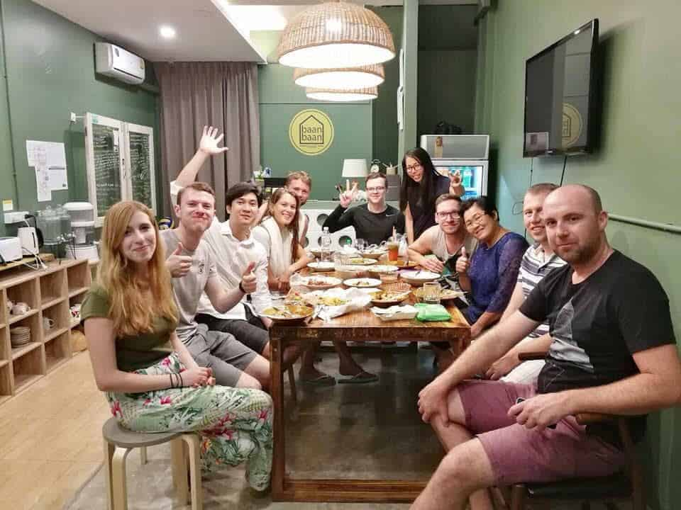 Backpackers enjoying meal at the Restaurant of Baan Baan Hostel, Thailand