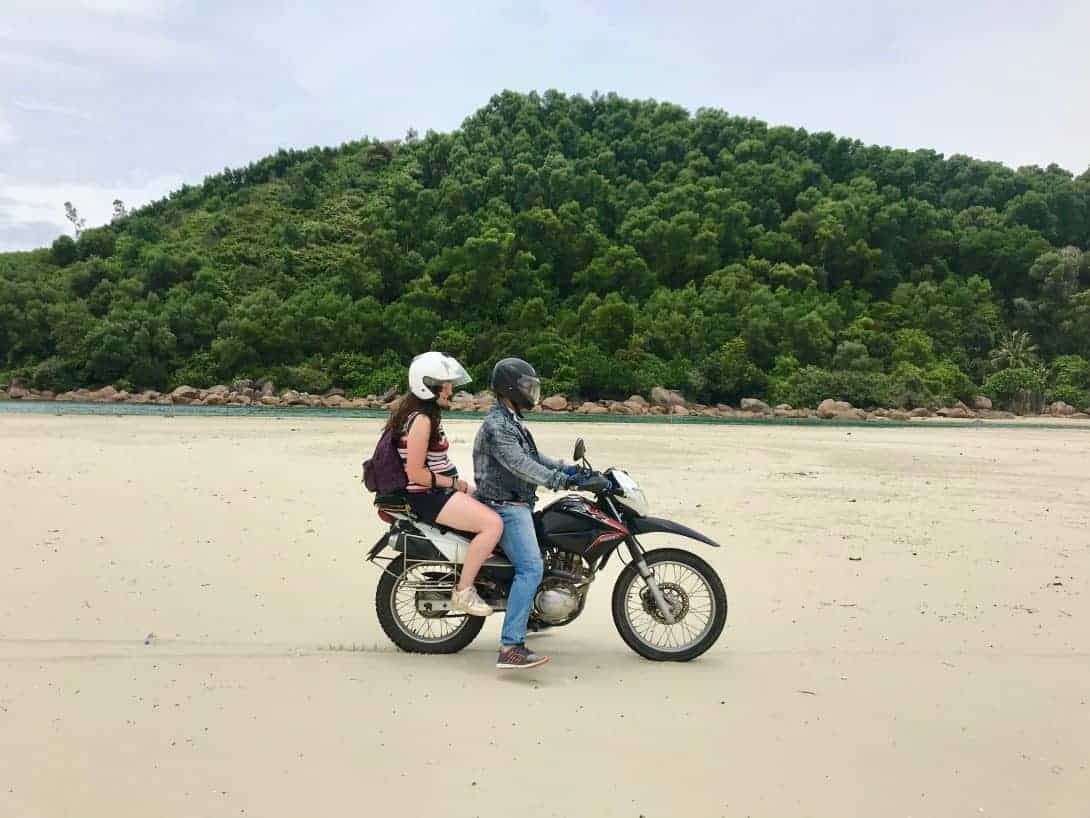 Riding along the beach in Vietnam on the Hai Van Pass & Beyond Tour.