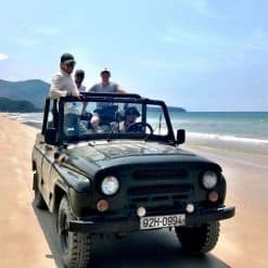 Riding on the beach on the Hai Van Pass Jeep Tour.