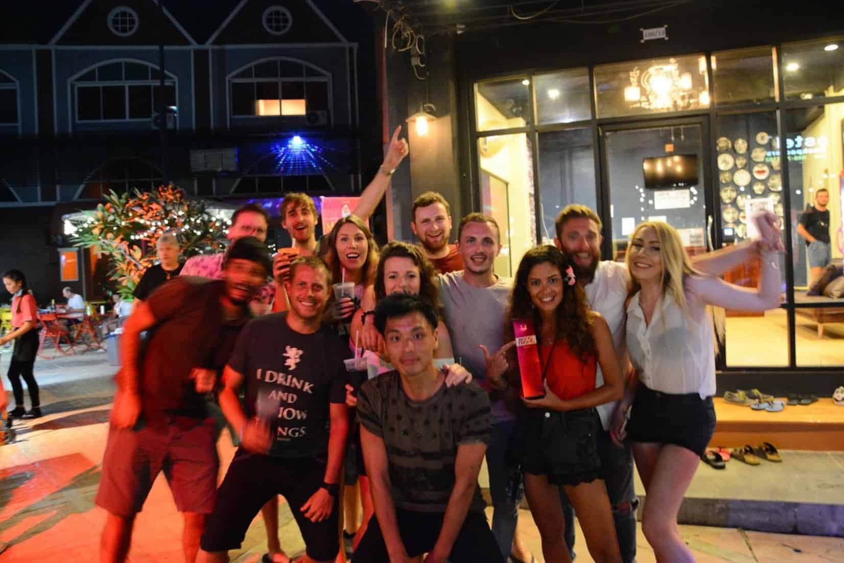 Backpackers are all smiles as they gleefully posed for a shot at Fin Hostel, Phuket, Thailand.