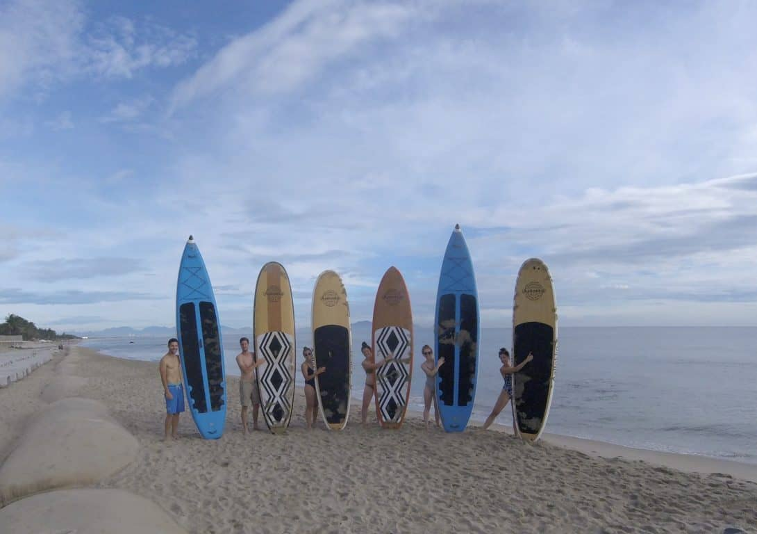 6 paddleboards standing vertically on An Bang Beach