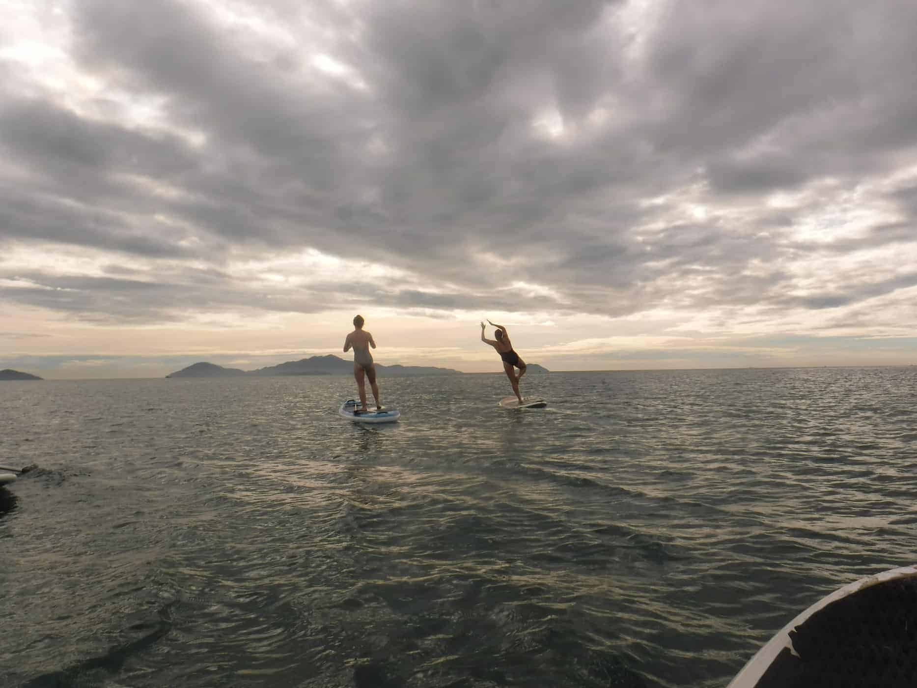 Two Backpackers Struggle to Stay on Their Feet Whilst Paddleboarding in Hoi An, Vietnam.