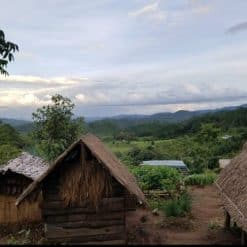 View of mountains with village huts, Doi Inthanon.