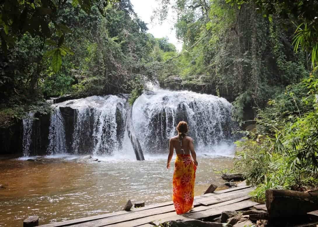 A backpacker facing a beautiful waterfalls - Maewang, Thailand