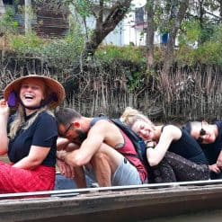 Having fun on a boat trip on the Mekong Delta.