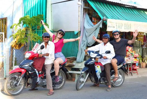 Riding pillion on the Mekong Madness Tour, Vietnam.