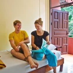backpackers enjoying the warmth of the orange room_CocoHostel_Khao Sok Thailand