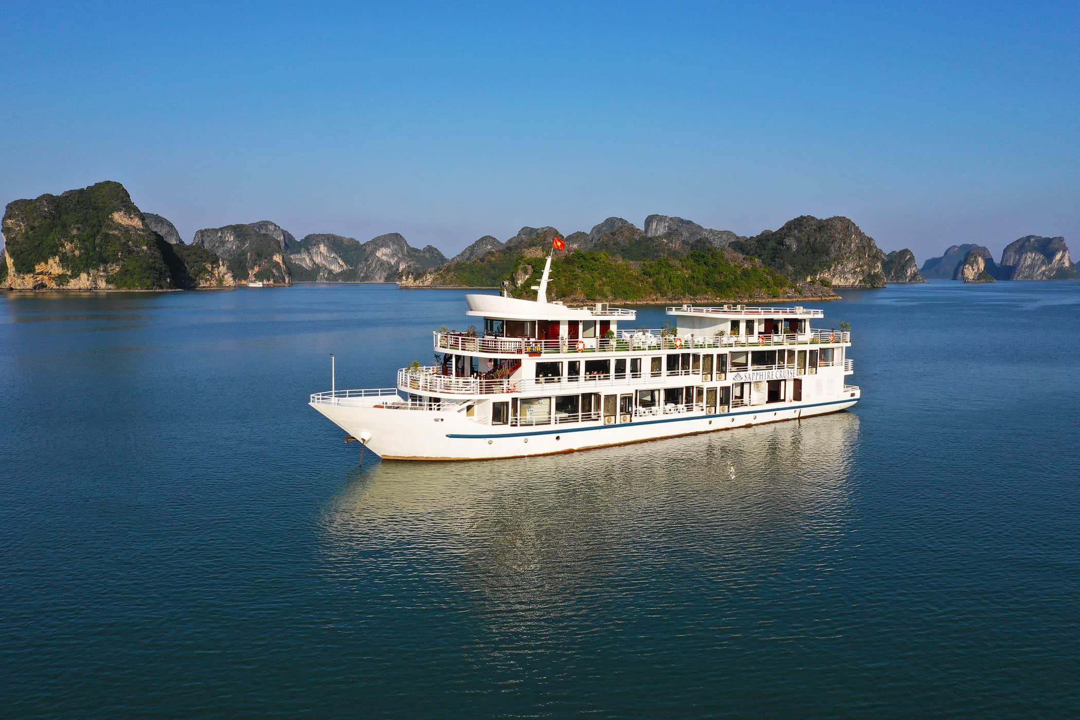 A White Cruise Ship on Dark Blue Water, Lan Ha Bay, Vietnam.