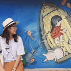 A girl visits Tam Thanh Mural Village Hoi An