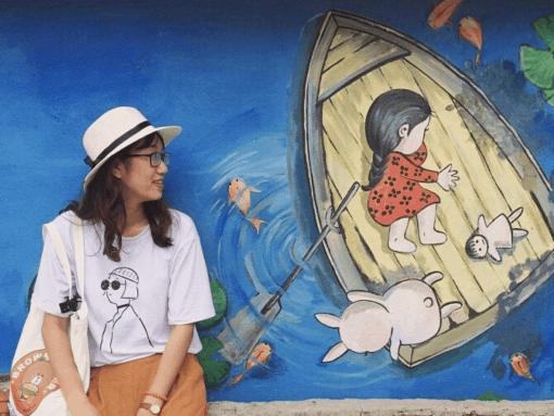 A girl visits Tam Thanh Mural Village Hoi An