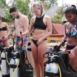 Divers prepping their tanks Nusa Lembongan Indonesia