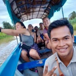 backpackers on a boat Mey Chrey Siem Reap Cambodia