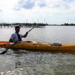 tourist kayaking in Trav Kot Cambodia