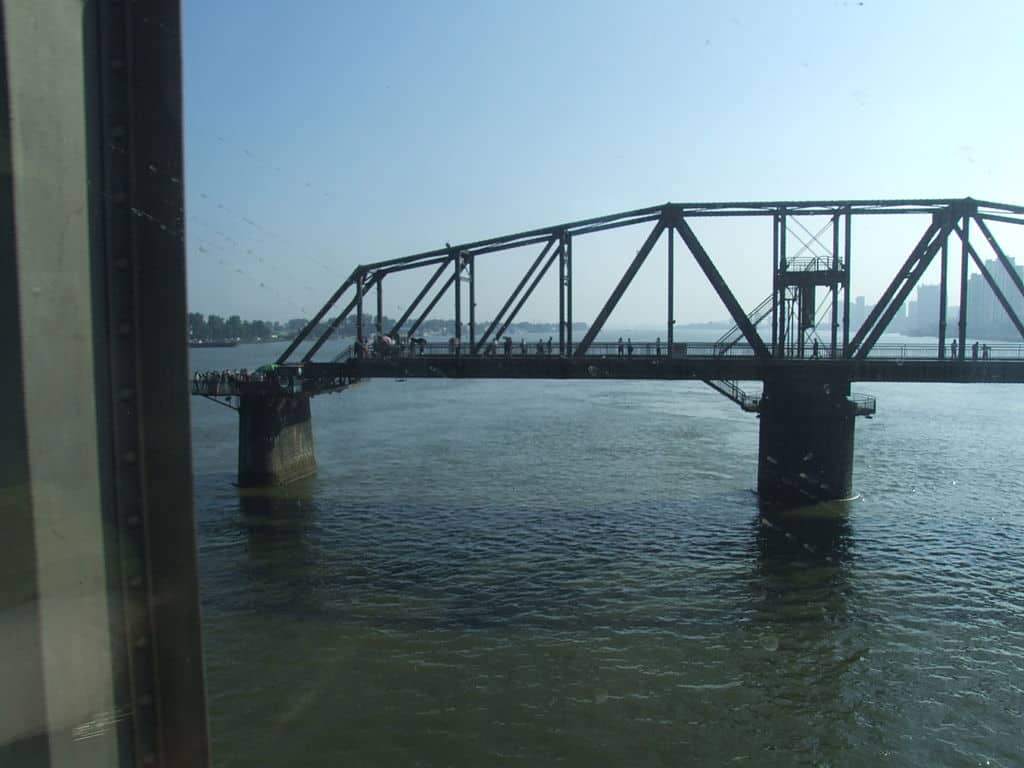 The Broken Bridge From The Chinese Border City of Dandong, That Used To Link To Yeng Byen, North Korea Over The River Yalu