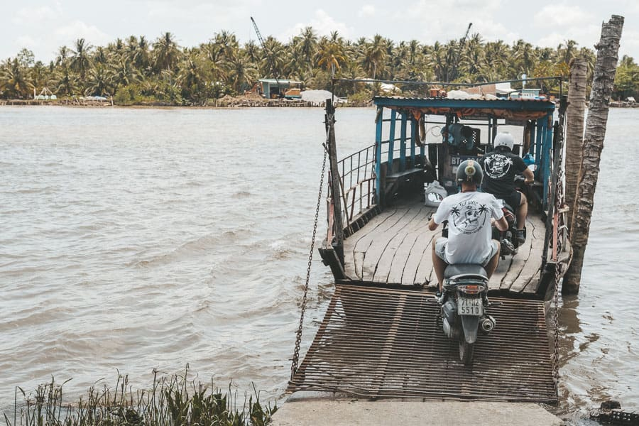 Some Travellers on Motorbikes Get Onto a Small Wooden Ferry