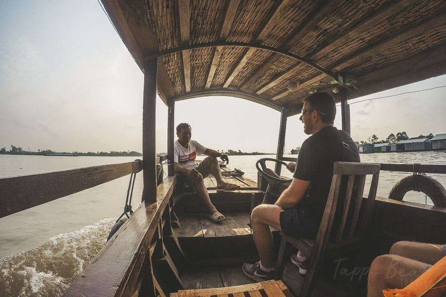 Skipper and Ian driving the boat down the mekong