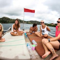 A Group of Travellers Lounging on the Sun Deck of a Dive Boat off Flores, Indonesia