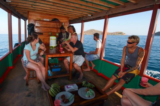 Travellers Relax on the Boat on a Dive Trip in Komodo