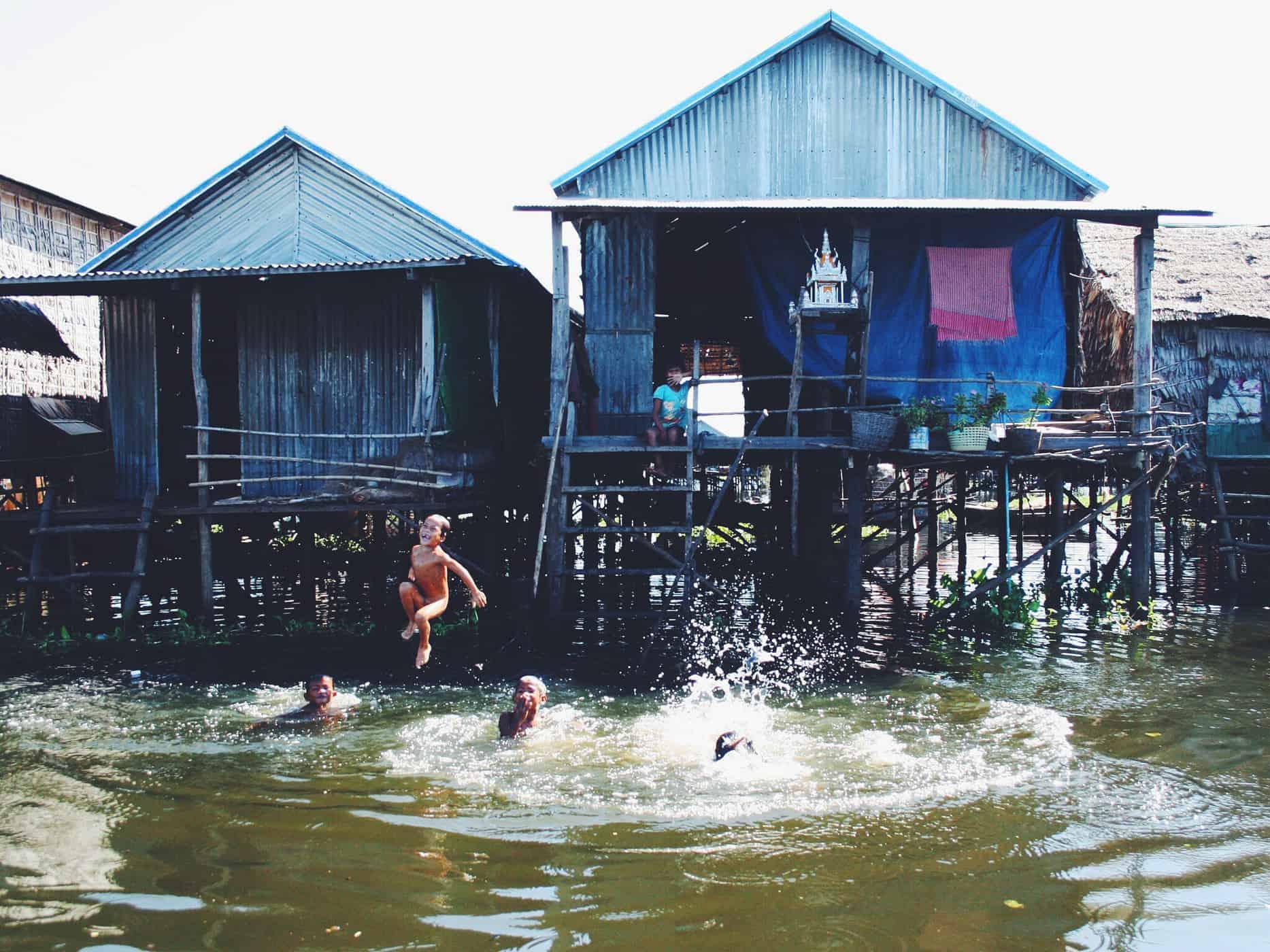 Local kids splashing around in the village.