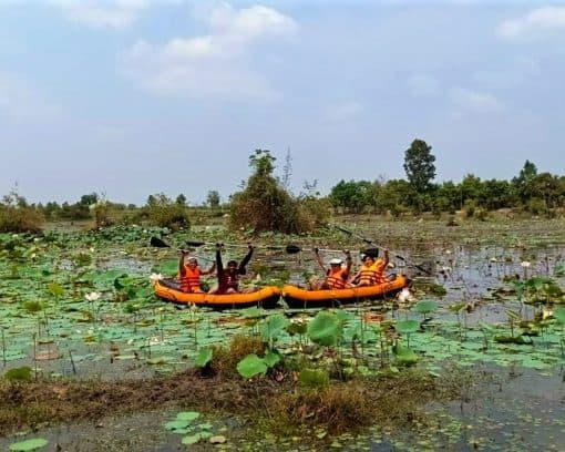 Kayaking amidst Lotus field Trav Kot Cambodia