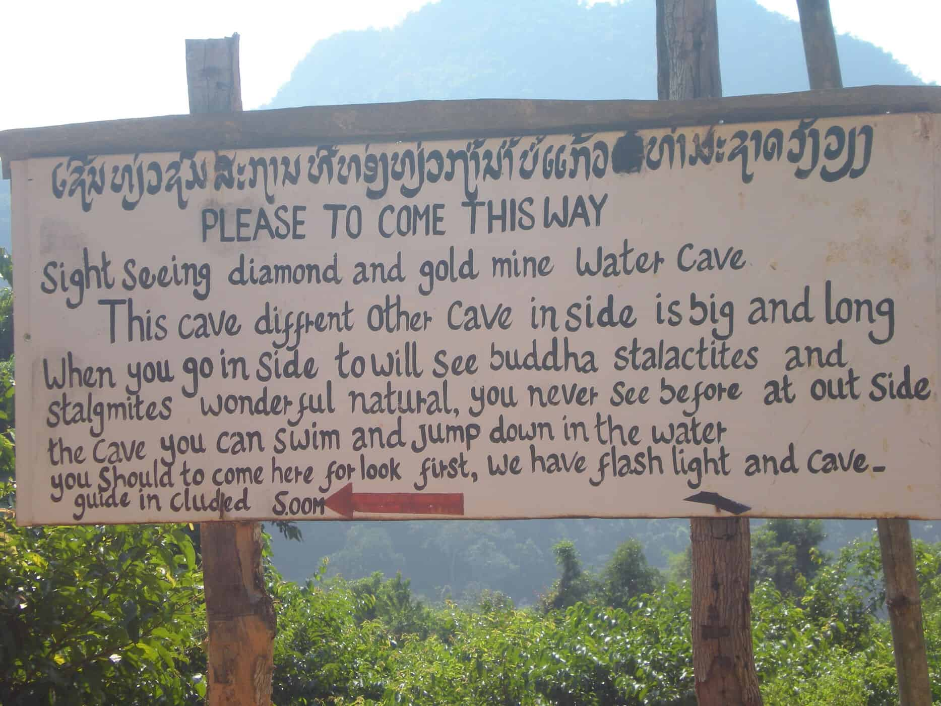 Sign to cave in Vang Vieng, Laos.