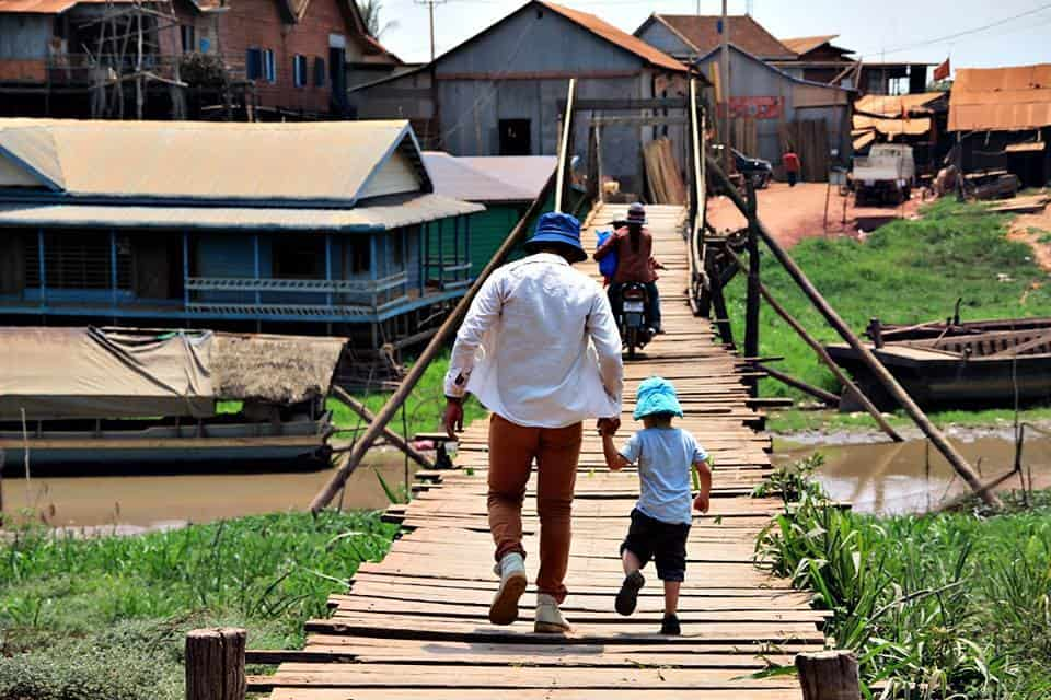 A father and child on the walkways of Kompong Khleang Village, Cambodia.