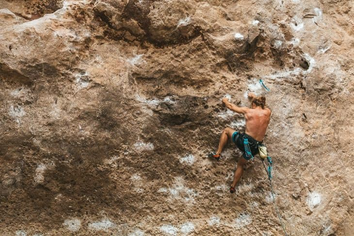Professional Climber Taking on Difficult Routes at Railay