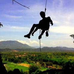 Man climbing with rope with nice background