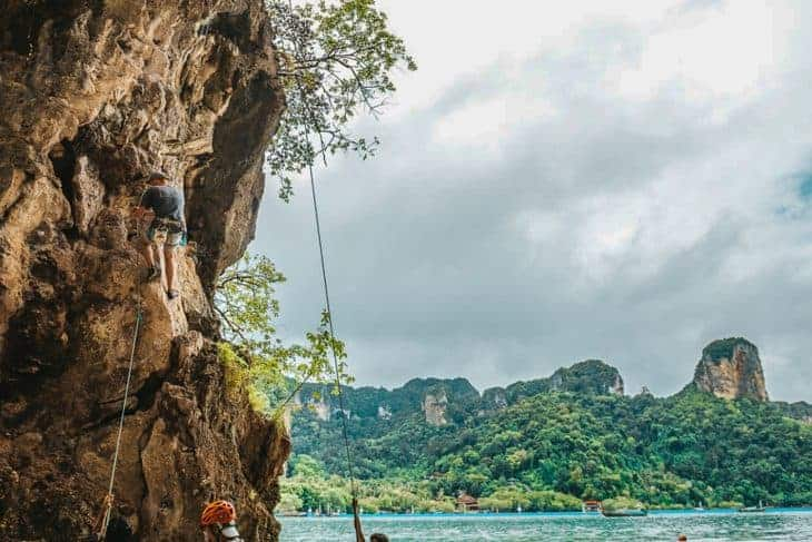 Climbing at Railay Beach with a Backdrop of Karst Cliffs and the Sea