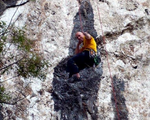 Man climbs on wall