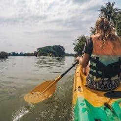 Girl kayaks down Mekong