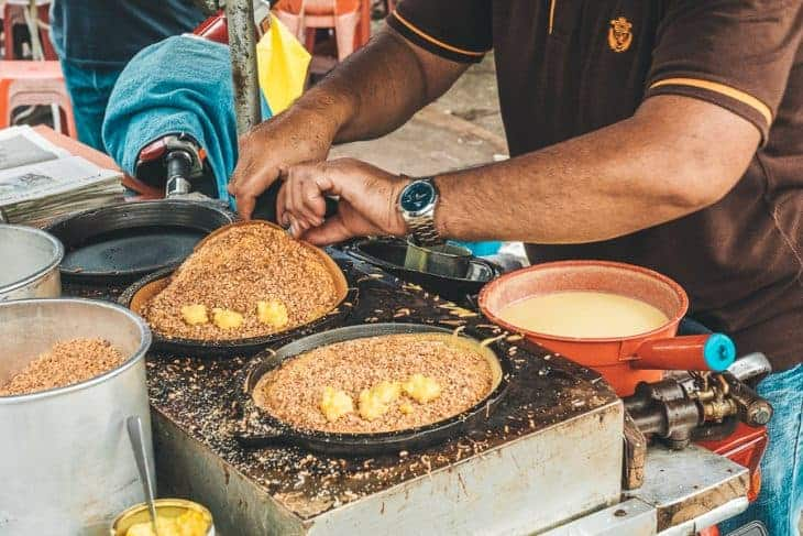Stallholder Cooking Apam Balik Pancakes at Chow Kit Market