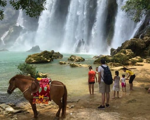 Horses by Ban Gioc Waterfall by Ann De Munck