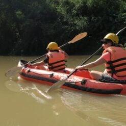 Two people kayak through National Park