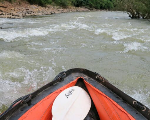 Kayak pointing downriver