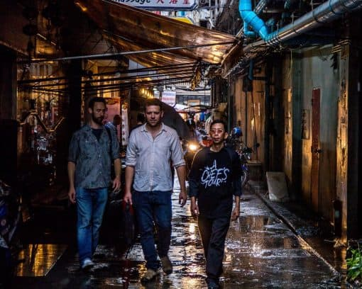 People walk through Bangkok on food tour