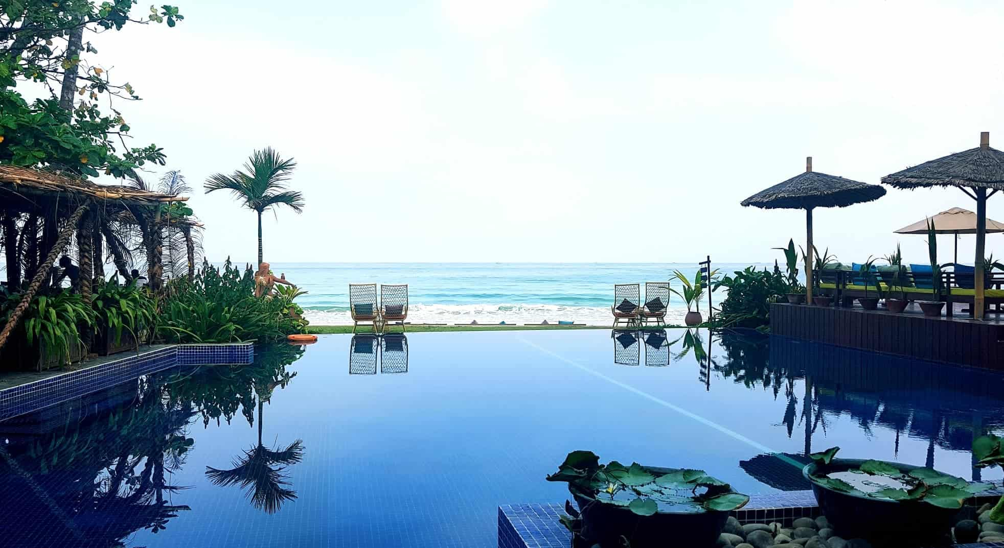 Oceanfront view and swimming pool at Amata Resort, Ngapali Beach, Myanmar.