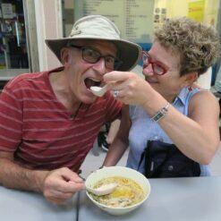 Woman feeds man