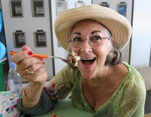 Woman tastes food