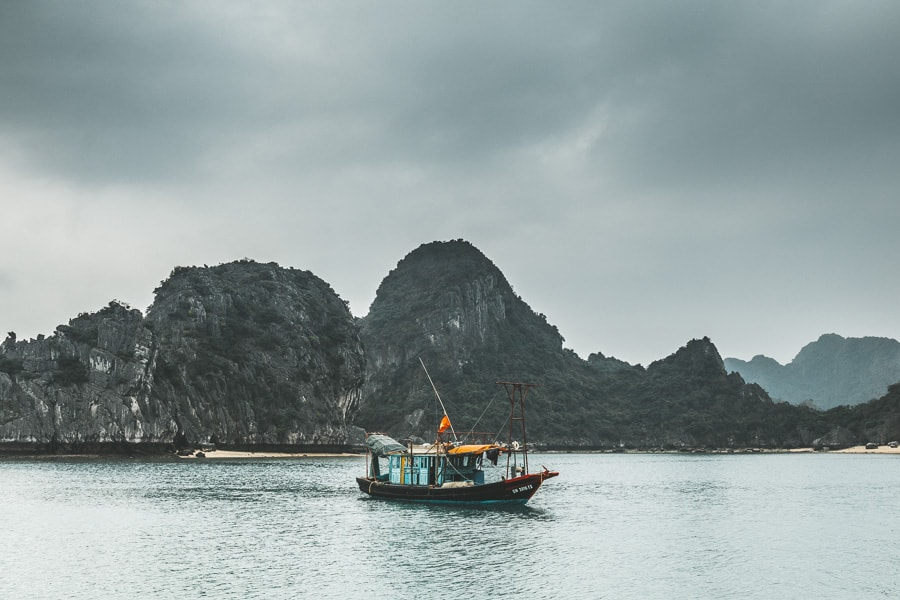 Fishing Boat in Lan Ha Bay on a Cloudy Day
