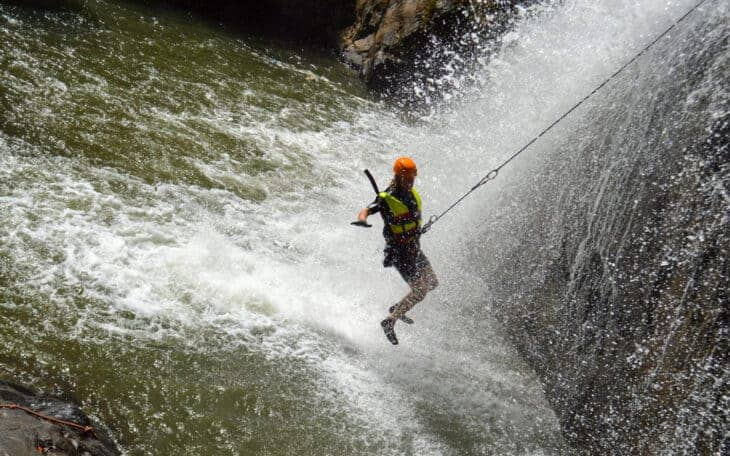 Person abseils down waterfall