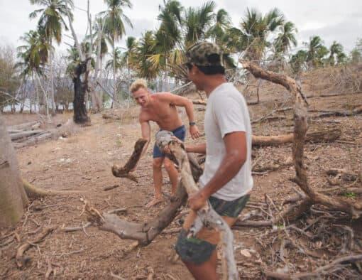 Men prepare camp on island