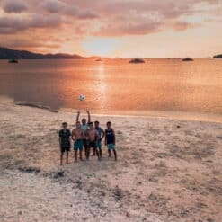 Group of backpackers on one of secret Gili Islands, Lombok