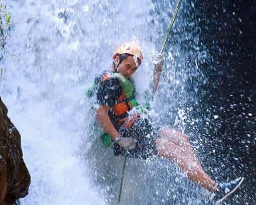 Man abseils down waterfall