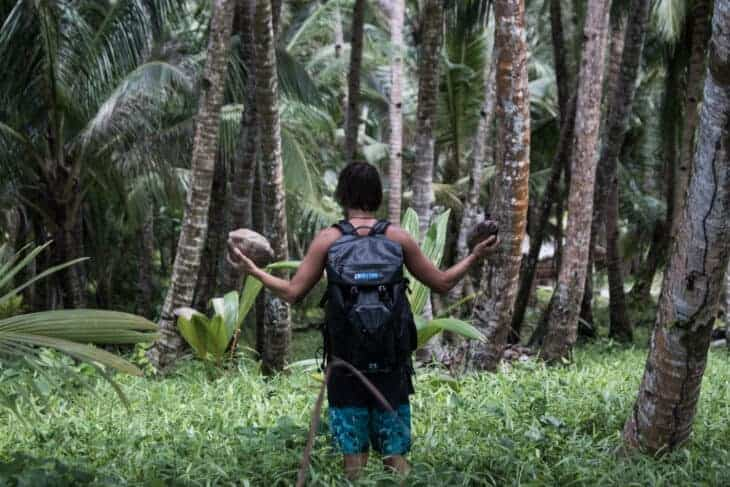 Man in jungle with waterproof backpack.