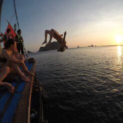 Girl flips off boat