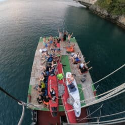 View of backpackers on boat from above.